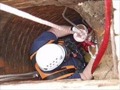 Confined Space Training - Person Going Down Well on Harness