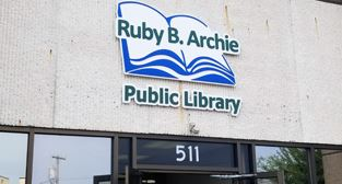 Ruby B. Archie Public Library sign outside building entrance