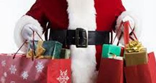 Holiday shopping - Santa holding gift bags