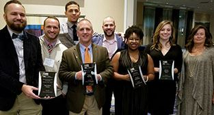 Parks and Recreation staffers display awards
